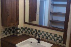 造作の洗面カウンターとメキシカンタイル